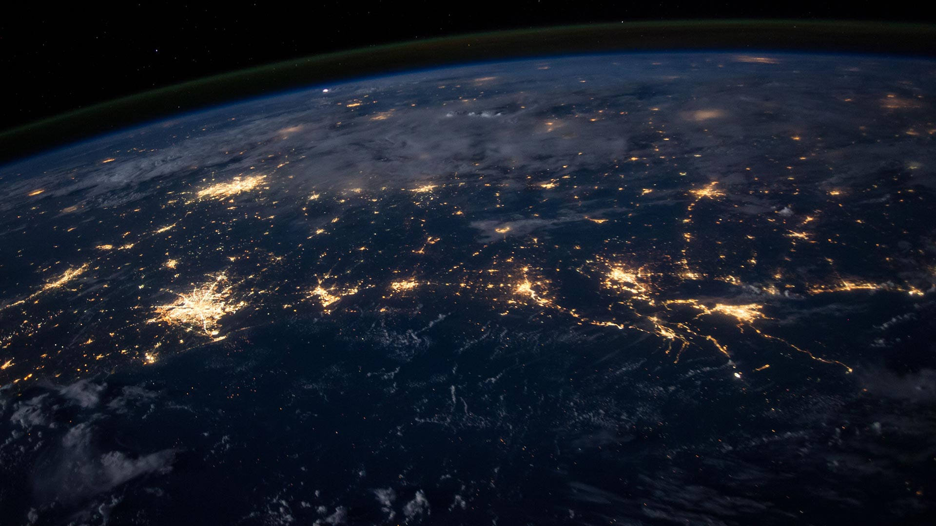 A night time view of lit up cities on Earth from space