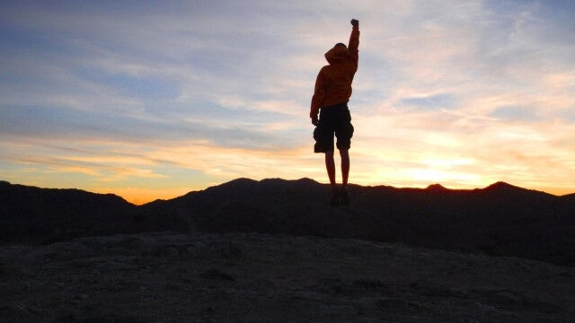 A hiker at sunrise or sunset.