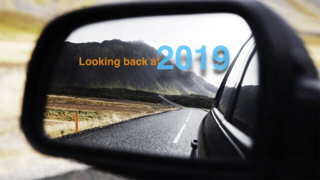 A rear view mirror with the words Looking Back at 2019