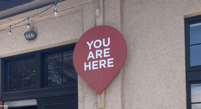 A sign on a wall that says