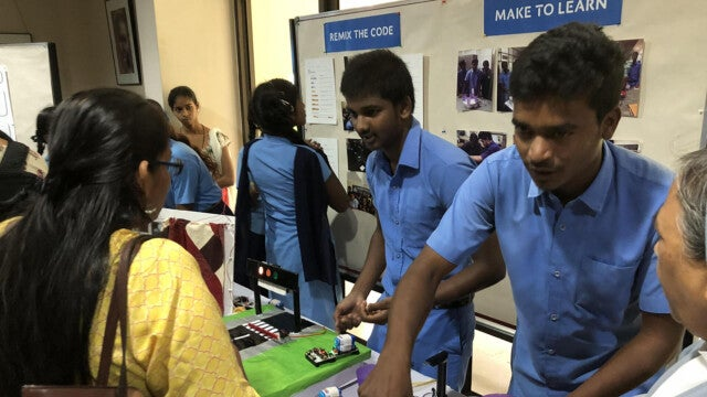 Kids exhibiting projects at Quest 2 Learn